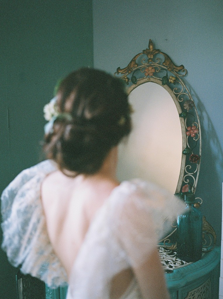 film photography girl looking into mirror image wedding bridal